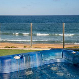 Modelo de piscinas y jacuzzis elevados, contemporáneos, de tamaño medio, en azotea