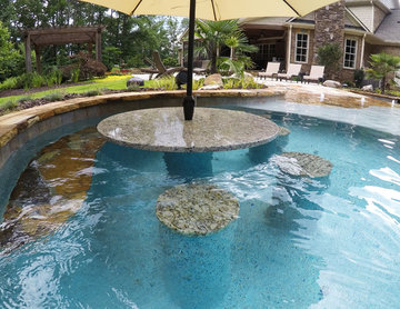 Natural freeform pool with Cave and Beach entry