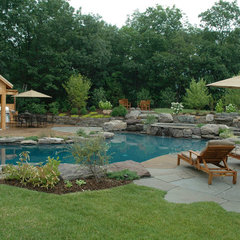 traditional pool by Jardin Passion Landscape Designers