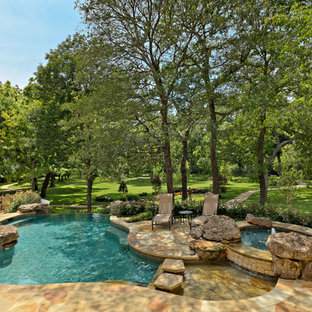 Example of a classic stone and custom-shaped pool design in Dallas
