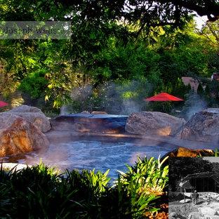 Mid-sized elegant backyard custom-shaped natural hot tub photo in New York