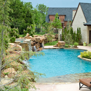 Inspiration for a mid-sized timeless backyard stone and kidney-shaped lap pool fountain remodel in Oklahoma City