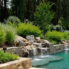 Contemporary Pool by SURROUNDS Landscape Architecture + Construction