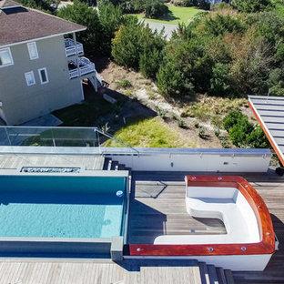 Esempio di una piscina fuori terra stile marinaro rettangolare sul tetto con pedane