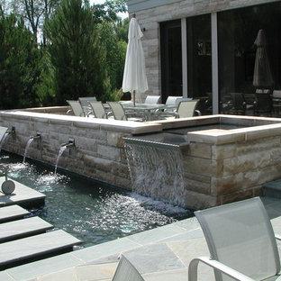 Large minimalist aboveground pool photo in Detroit