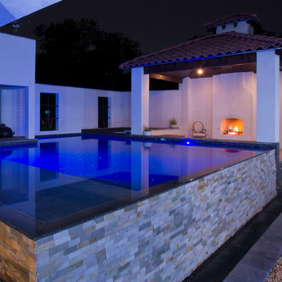 Small trendy courtyard concrete and custom-shaped infinity pool fountain photo in Austin