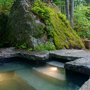 Design ideas for a mid-sized country backyard custom-shaped natural pool in Portland Maine with a hot tub and natural stone pavers.