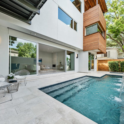 Example of a mid-sized trendy backyard stone and custom-shaped pool fountain design in Houston