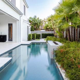 Example of a trendy backyard rectangular lap pool design in Orlando