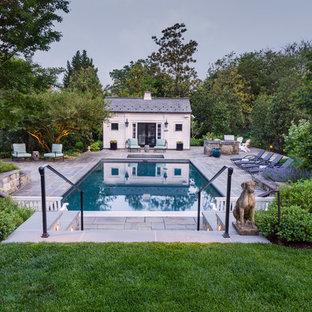 На фото: большой прямоугольный, спортивный бассейн на заднем дворе в стиле современная классика с домиком у бассейна и покрытием из каменной брусчатки с