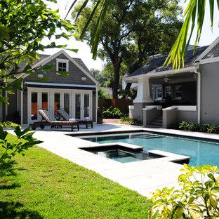 Imagen de piscinas y jacuzzis alargados, de estilo americano, grandes, rectangulares, en patio trasero, con losas de hormigón