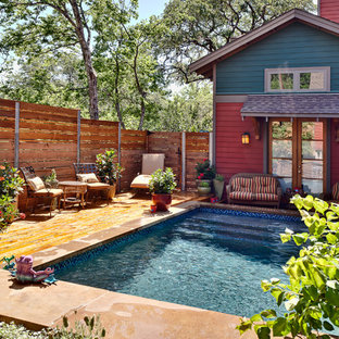 Design ideas for a mid-sized country backyard rectangular lap pool in Austin with concrete pavers.