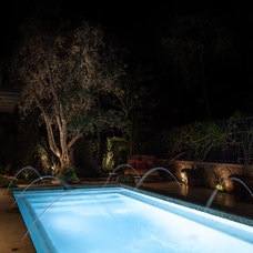 Traditional Pool by Studio H Landscape Architecture