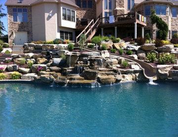 North Whitehall custom pool with boulder waterfall, slide, & separate spa