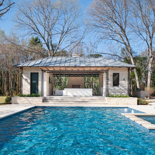 Contemporary rectangular swimming pool in Dallas with a pool house.