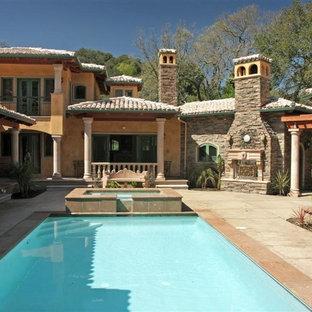 Inspiration for a mediterranean courtyard rectangular pool remodel in San Francisco