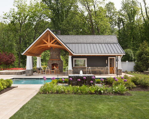 large elegant backyard rectangular lap pool house photo in dc metro with concrete pavers