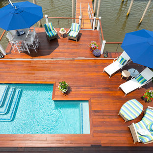 Design ideas for a mid-sized beach style l-shaped pool in Philadelphia with decking.