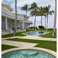 Tropical Pool by Blakely and Assoc. Landscape Architects, Inc.