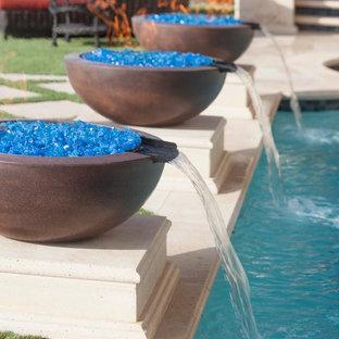 Pool fountain - small mediterranean backyard stone and rectangular pool fountain idea in Tampa