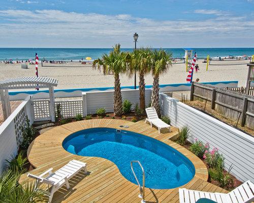 Piscine bord de mer en forme de haricot photos et id es for Decoration bord piscine