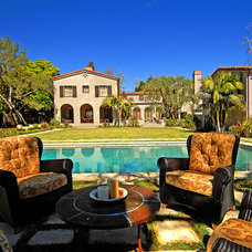 Mediterranean Pool by Tommy Chambers Interiors, Inc.