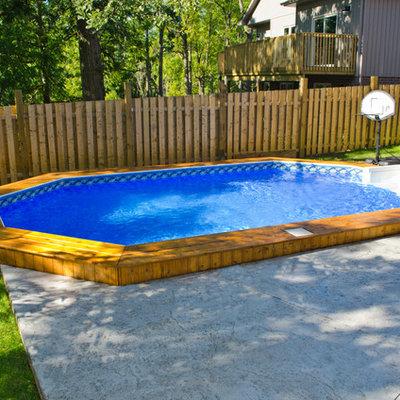 Mid-sized elegant backyard custom-shaped and concrete aboveground pool photo in Toronto
