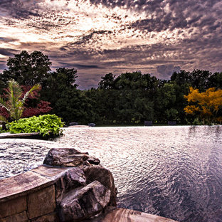 Example of a large mountain style backyard stone and custom-shaped natural pool fountain design in Nashville
