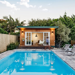 Design ideas for a contemporary rectangular pool in Melbourne with a pool house.
