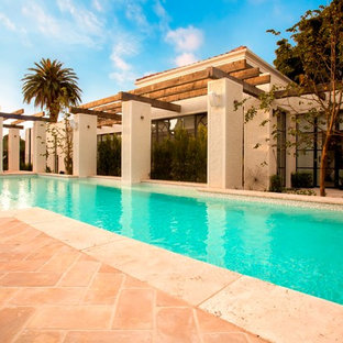 Mediterranean pool in Melbourne with brick pavers.