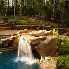 Traditional Pool by Sunmar Construction