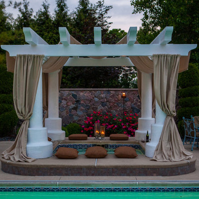 Inspiration for a large timeless backyard rectangular and concrete lap hot tub remodel in Other