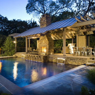Inspiration for a rustic rectangular pool house remodel in Dallas