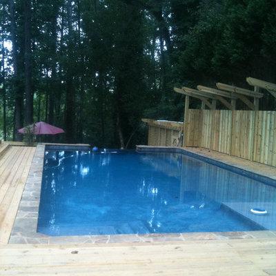 Pool - large traditional backyard rectangular lap pool idea in San Francisco with decking