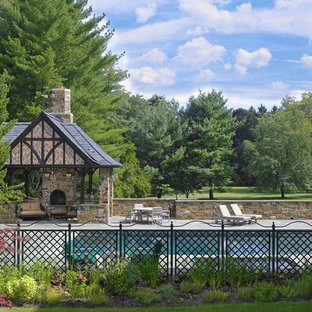 This is an example of a traditional side rectangular swimming pool in Philadelphia with a pool house and natural stone paving.
