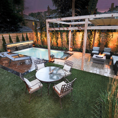 Inspiration for a timeless backyard rectangular pool fountain remodel in Toronto