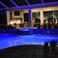Contemporary Pool by Premier Outdoor Living & Design