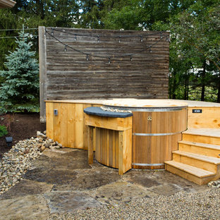Design ideas for a small country backyard round pool in Toronto with a hot tub and decking.