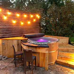 Inspiration for a small country backyard round pool in Toronto with a hot tub and decking.