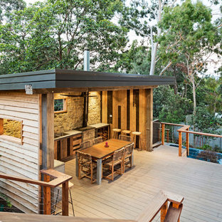 Inspiration for a mid-sized contemporary backyard tile and rectangular infinity pool remodel in Melbourne