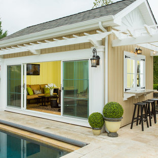 Pool house - traditional backyard tile and rectangular pool house idea in Wilmington