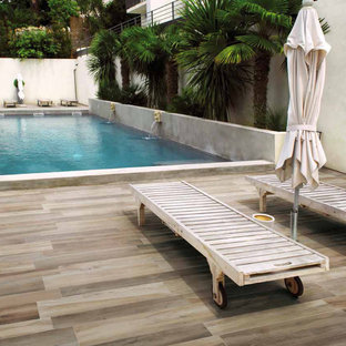 Outdoor pool patio with porcelain tile floors