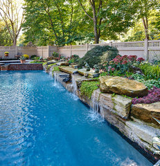traditional pool by Creative Design Construction, Inc.