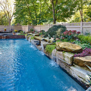 Inspiration for a traditional rectangular natural pool in New York.