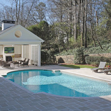 Traditional Pool by Paces Construction Co