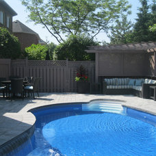 Traditional Pool by Rooms of Distinction Inc.