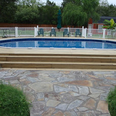 Traditional Pool by The Above Ground Pool & Spa Company