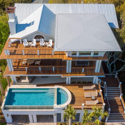 Minimalist aboveground pool photo in Charleston with decking