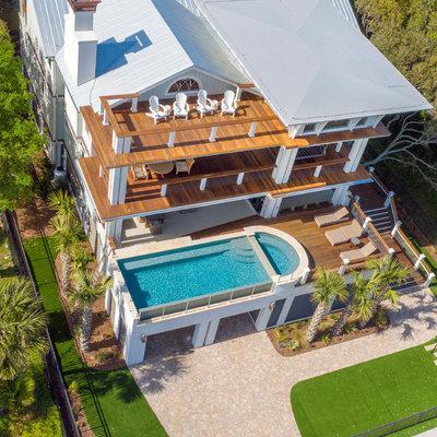 Pool - modern aboveground pool idea in Charleston with decking