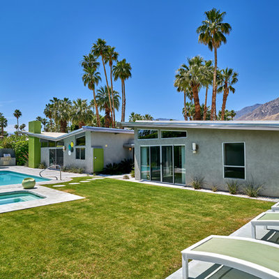 Inspiration for a large 1960s backyard rectangular natural pool remodel in Other